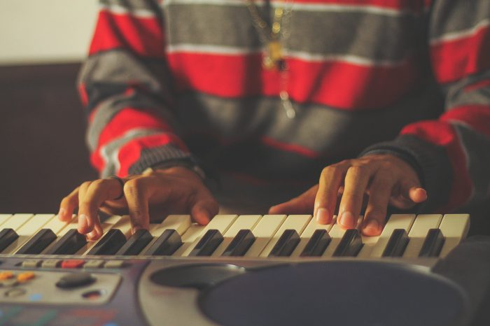 young man playing midi keyboard