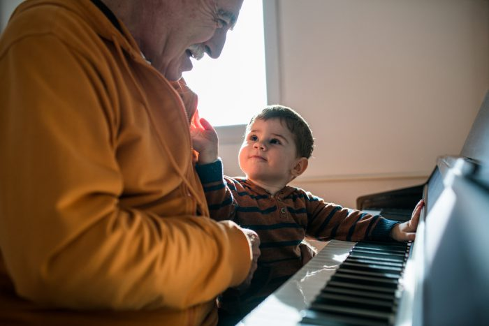 baby and grandpa at piano