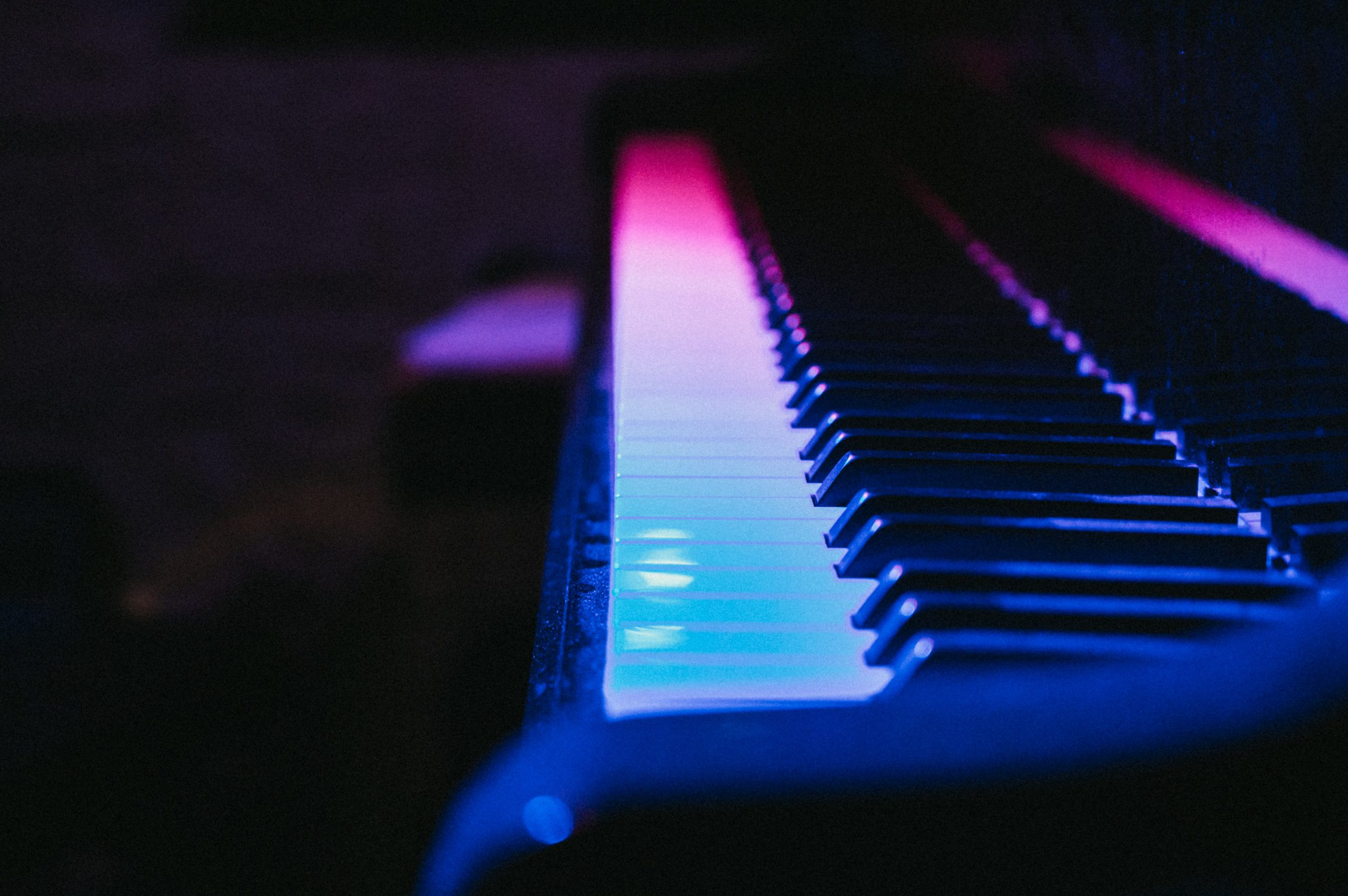 piano with pink and blue lights