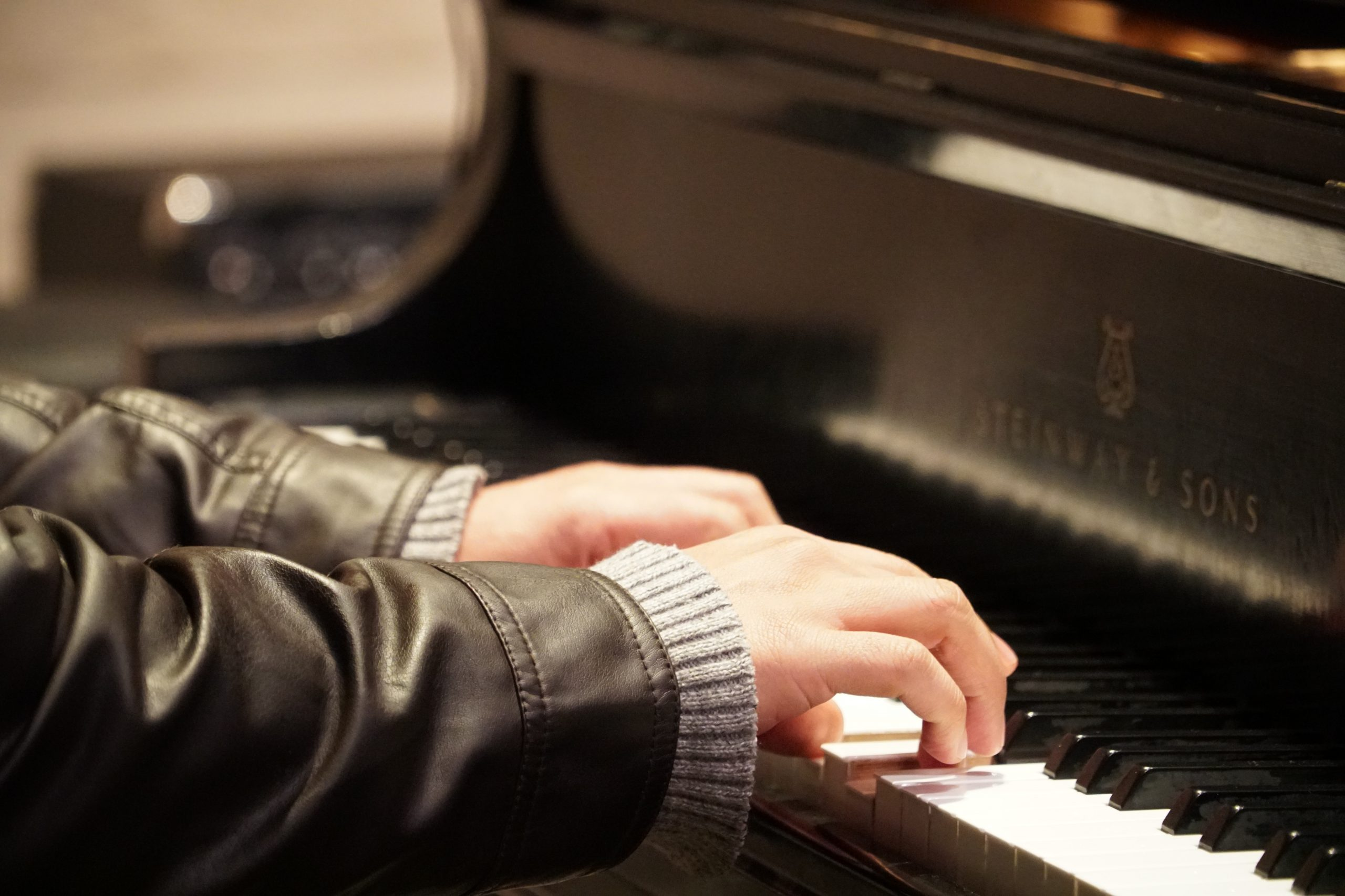 piano player with jacket and sweater